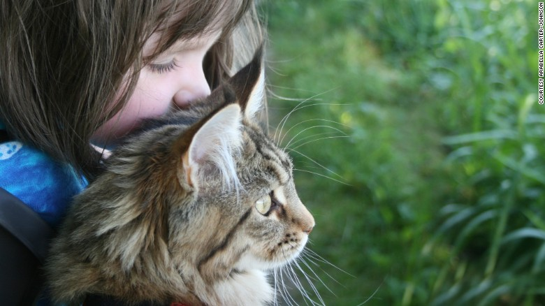 Different is brilliant: Portrait of a 6-year-old artist and her cat